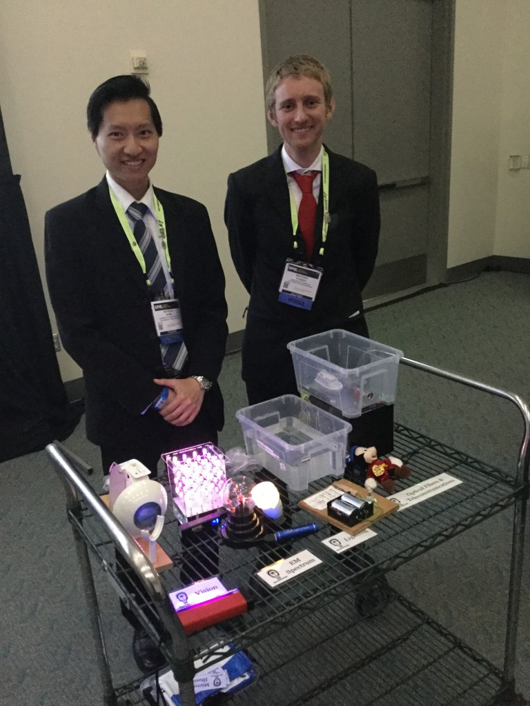 Suited to educate: Nicholas and I presenting our oortable hands-on optics experiments suite at the 2016 SPIE Optics + Photonics congress.