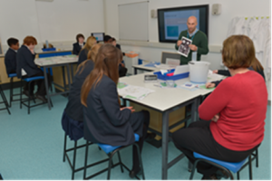 A Meet the Scientist session in the LifeLab classroom at Southampton General Hospital. Researchers lead a ten minute session with a group of approximately eight Year 9 pupils.