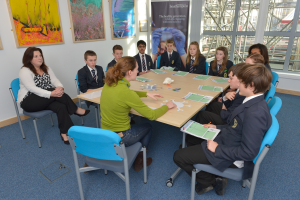 After completing the LifeLab 'Meet the Scientist' training a Cancer Research scientist leads her first session with 10 Year 9 pupils and their teacher.