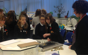 Year 9 pupils investigate friction during Dragonfly Day—a day of engineering workshops run by female engineering researchers for female pupils.