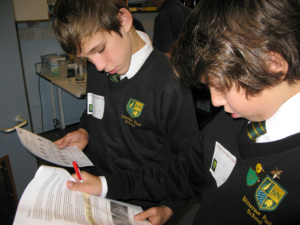 School pupils examine the evidence during Murder in the Medical School, a workshop run by the Biomedical Imaging Unit.